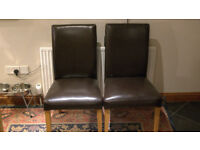 Two Ikea leather dining room chairs in excellent condition