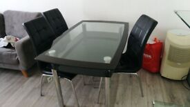 GLASS DINING TABLE wt 4 CHAIRS