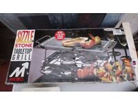 Sizzle stone tabletop grill