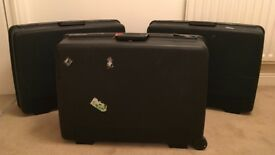 3 Delsey Club black hardshell suitcases and matching vanity case