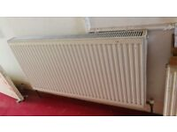 batch of white single panel and double panel compact radiators