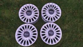 "Fiat 500 set of Four 15"" alloy wheels."