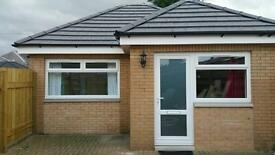 Furnished detached one bedroom flat with patio and off street parking