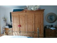 Solud pine four door two drawer wardrobe