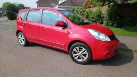 Red Nissan Note Acenta 2009