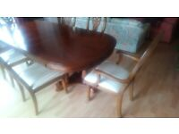 Beautiful mahogany finished polished dining table and six chairs