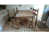 Corona dining table & 4 chairs , used but still in good condition .