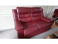 Burgundy two seater sofa