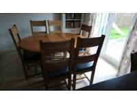 Solid oak dining table extendable with 6 chairs