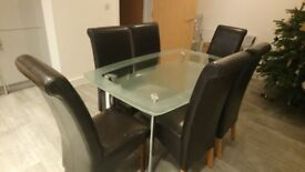 Glass Table with 4 Faux Leather Chairs