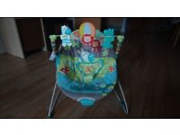 Baby bouncer with vibrator