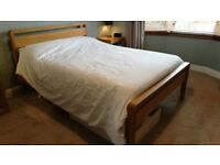 Wooden bed frame in solid Oak from Bensons for Beds