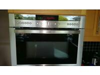 Neff built in multifunction oven with microwave and grill.