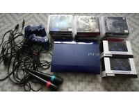PS3 500GB azure blue super slim console, all leads, Singstar mics, 4 controllers, 18 games