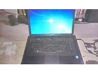 Compaq Presario CQ57 laptop windows 7, outer casing has scratches but works 100%