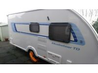 Sprite Musketeer TD 2012 5 berth caravan and awning