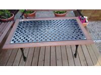 Cast garden bench and table