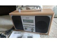 Bush DAB digital radio. Wood surround. Small and portable. Cost £40