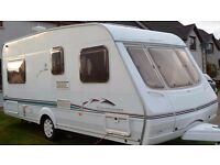 2002 Swift Charisma fixed bed 4 Berth touring caravan with awning & motor mover