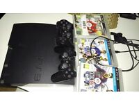 Sony Playstation 3 PS3 + FIFA14, GTA 5, COD + 17 Games + 2 Controllers