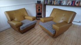 1960s Retro pair of armchairs. Slight scuffs but overall very good condition . Recovered cushions