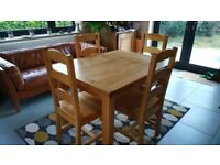 Solid Oak 8 seater extending table and 4 chairs