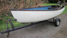 10'5 fibreglass dinghy with wood trim, trailer & seagull 40+ outboard in good working order
