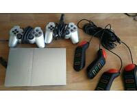 PS2 with Buzz controllers and games