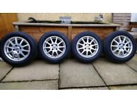 Set of four, 5.5x14, 10 spoke alloy wheels .