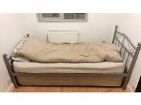 metal single bed with extra sliding bed for guests underneath