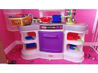 Little tikes large plastic kitchen with pans, food and utensils. Microwave oven and toaster