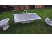 Bath and sink and toilet