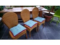 6 rattan dining chairs with seat pads