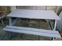 Wooden picnic bench with table