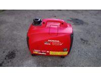 Honda portable generator hardly used. Eu1.0i suitcase / quiet electric generator