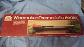 Demi John heater for wine making