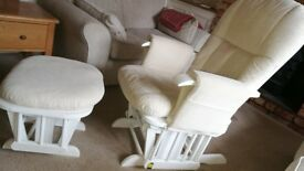 White chair and foot stool with beige cushions. Rocker chair and rocker stool.