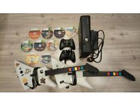 Xbox 360, two controllers, two guitars, 9 games, no packaging.