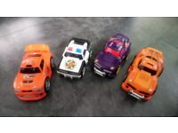 """4 excellent condition """"Shake and Go"""" race cars"""