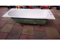 Cast iron bath with claw feet and basin with brackets