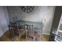 Glass dining table and four chairs - £15ono