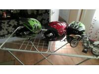 Three new boys helmets size s and motocross bike for shelf