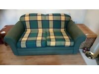 Green checked 2 seater sofa