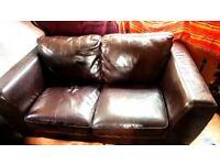 Chocolate brown (fake?) leather sofa