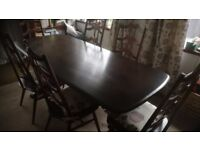 Ercol dining table and 6 chairs.