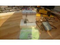 X2 sewing machines and 1 overlocker