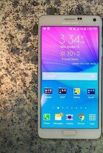 Samsung note 4 good condition  locked to wind
