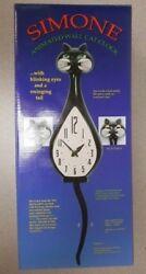 1 BLACK SIMONE WALL CAT CLOCK NIB W/ BLINKING EYES AND A SWINGING TAIL VERY RARE
