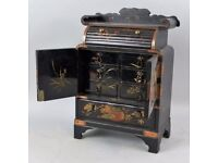 Japanese black lacquered table cabinet, with chased copper hinges and mounts