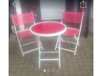 Great little bistro garden set, two chairs and a table.